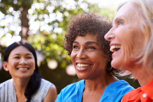 Older women smiling after making a decision to get All On 4 Instead of Dentures from their Oral Surgeon in Glendale, AZ at Arrowhead Oral and Maxillofacial Surgery.