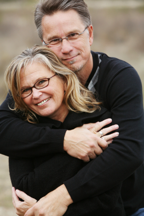 Middle aged couple embracing, after facial truama surgery in Glendale at Arrowhead Oral and Maxillofacial Surgery.