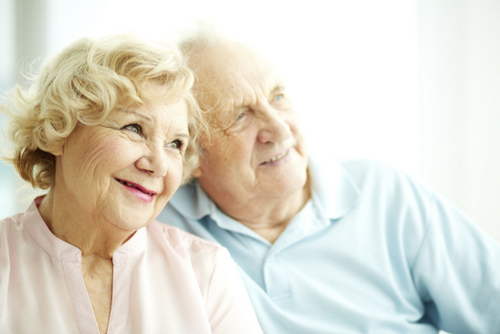 Older couple smiling after making a decision on a solution for their tooth loss after talking with their Oral Surgeon in Glendale, AZ at Arrowhead Oral and Maxillofacial Surgery.