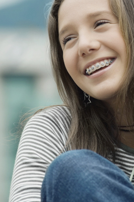 Young girl with braces smiling. Arrowhead Oral and Maxillofacial Surgery Oral Surgeon in Glendale, AZ.
